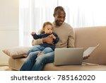 paternal leave. cheerful dark... | Shutterstock . vector #785162020