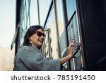 happy woman ringing on doorbell ... | Shutterstock . vector #785191450