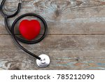 stethoscope with red heart on a ... | Shutterstock . vector #785212090