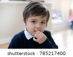 Active Little Boy Enjoy Eating...