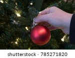 close up of hand hanging red...   Shutterstock . vector #785271820