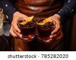 barman hands holding two... | Shutterstock . vector #785282020