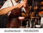 barman in a brown leather apron ... | Shutterstock . vector #785282050