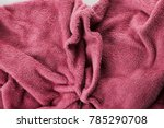 Small photo of Soft pink fabric shaped as female genital organs, vaginoplasty, labiaplasty