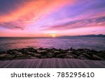 Blue Hour: Colorful ultra violet style sunset over the Mediterranean sea with a wooden walkway and rocks on the foreground. Slow shutterspeed