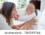young mother lying in bed with... | Shutterstock . vector #785295766