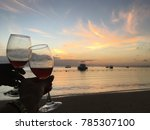 watching the sunset while two... | Shutterstock . vector #785307100