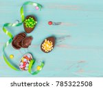 chocolate eggs on color wooden... | Shutterstock . vector #785322508