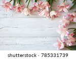 pink tulips on a wooden... | Shutterstock . vector #785331739