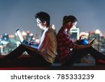 young asian couple using laptop ... | Shutterstock . vector #785333239