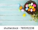 colorful easter eggs in nest...   Shutterstock . vector #785352238