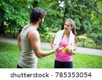 friends talking while doing... | Shutterstock . vector #785353054