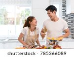 young asian woman cutting slice ... | Shutterstock . vector #785366089
