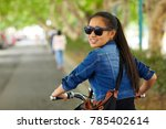 young asian woman on motorbike | Shutterstock . vector #785402614