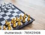 gold and silver chessmen on... | Shutterstock . vector #785425408