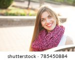 happy young woman sitting on a... | Shutterstock . vector #785450884