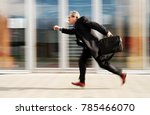 running businessman in front of ... | Shutterstock . vector #785466070
