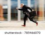 running businessman in front of ... | Shutterstock . vector #785466070