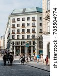 Small photo of Vienna, Austria - August 16, 2017: Street scene in Vienna in Michaelerplatz with Looshaus designed by Adolf Loos on background