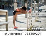 warming up for jogging by... | Shutterstock . vector #785509204