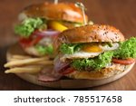 tasty burger with fried egg on... | Shutterstock . vector #785517658