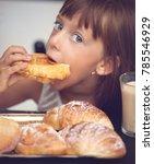 cute little girl has breafast   Shutterstock . vector #785546929