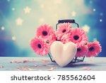 pink gerbera daisy in a basket... | Shutterstock . vector #785562604