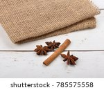Small photo of Star anis and cinnamon stick on wood