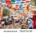 multicolored umbrellas in the... | Shutterstock . vector #785576740