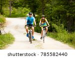 active young couple biking on a ... | Shutterstock . vector #785582440
