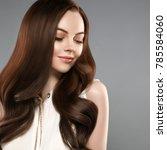 beautiful shine hair woman with ... | Shutterstock . vector #785584060