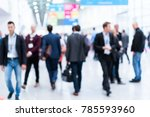 blurred people at a trade fair | Shutterstock . vector #785593960
