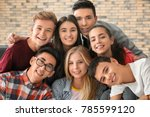 group of funny teenagers indoors | Shutterstock . vector #785599120
