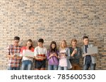 group of cool teenagers with... | Shutterstock . vector #785600530