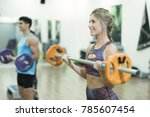 people training body pump and... | Shutterstock . vector #785607454