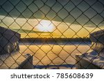 Sunset And Fence Winter