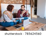 mature couple sitting at home... | Shutterstock . vector #785624560