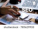businessman presses button seo... | Shutterstock . vector #785629933