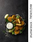 Small photo of falafel. Vegan roasted chickpeas patties with garlic yogurt sauce. Top view. black background