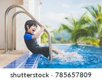 asian child splashing around in ... | Shutterstock . vector #785657809