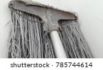 dirty mop on dirty white wall.   Shutterstock . vector #785744614