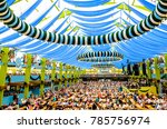 "MUNICH, GERMANY - SEPTEMBER 28: people in the ""Spaten""-beer tent at the biggest folk festival in the world - the octoberfest on september 28, 2017 in munich. - stock photo"