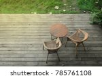 round table on wooden deck... | Shutterstock . vector #785761108