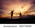 Silhouette Of Children Playing...