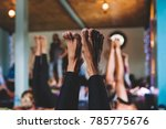 sweating people practicing yoga ... | Shutterstock . vector #785775676