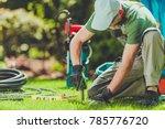 grass field sprinklers... | Shutterstock . vector #785776720