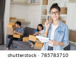 asian woman holding box with... | Shutterstock . vector #785783710