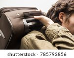 young handsome man holding...   Shutterstock . vector #785793856
