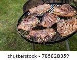 delicious meat stetaks cooking... | Shutterstock . vector #785828359
