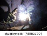 a man welds a metal with a... | Shutterstock . vector #785831704